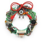 34608330 - geeky christmas wreath made by old computer parts isolated on white background